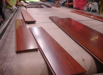 recycled wood flooring being inspected for quality